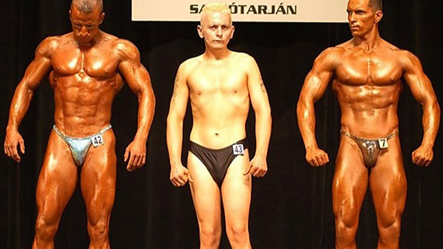 Why do bodybuilders tan? Look at this contestant that didn't have a tan, it's very difficult to see him on stage. (Picture of bodybuilder tan vs no tan)