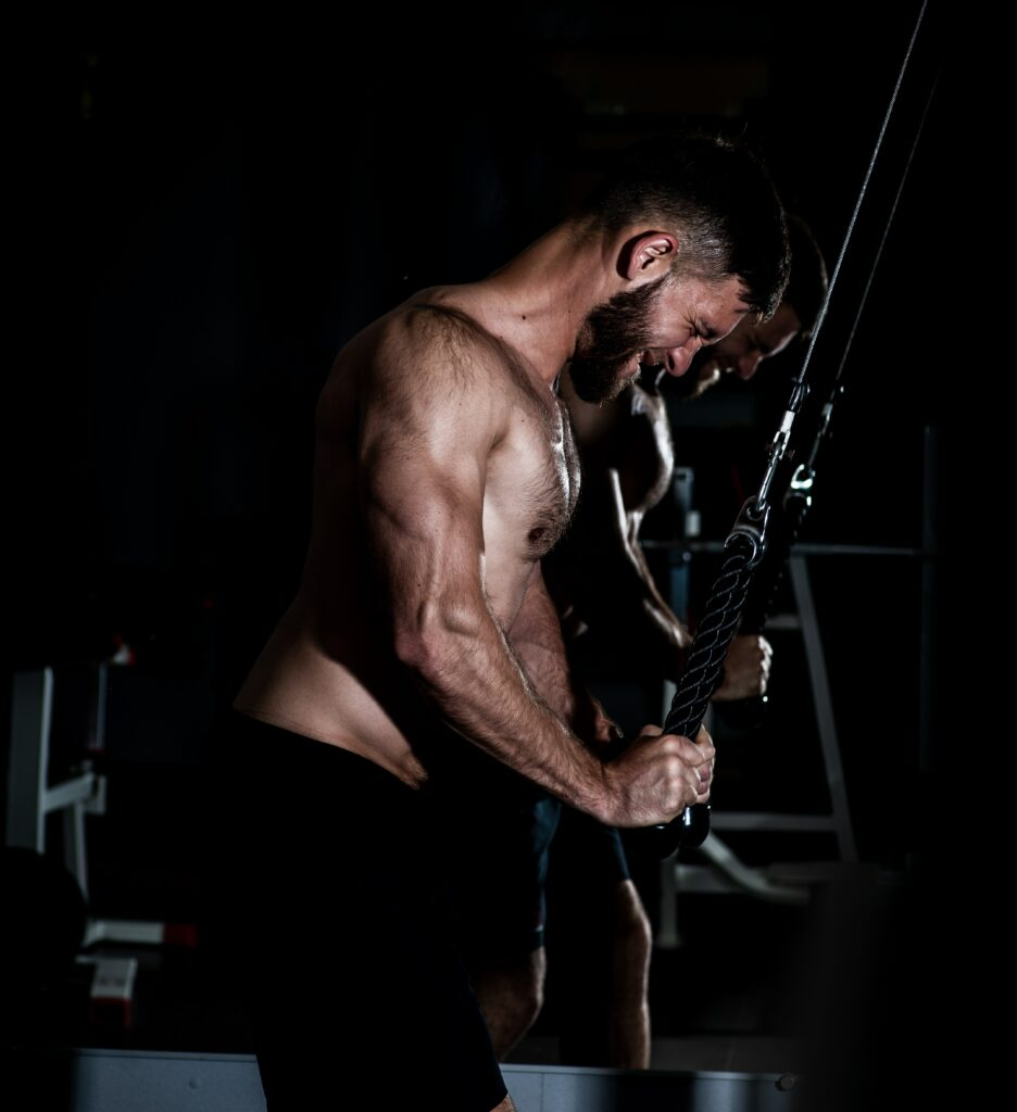 The 12 best tricep long head exercises, one of them being the cable tricep extension. Photo by Ruslan Khmelevsky